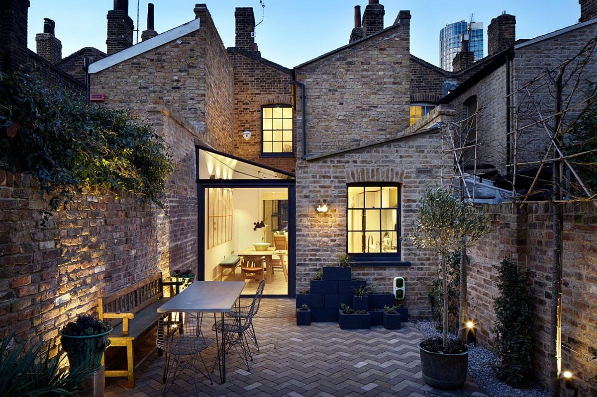 Elegant and non intrusive extension revitalizes traditional brick house in London