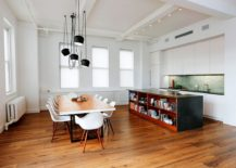 Elegant kitchen and dining area of the NYC apartment draped largely in white