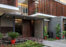 Entrance to the modern house combines Indian design with western style