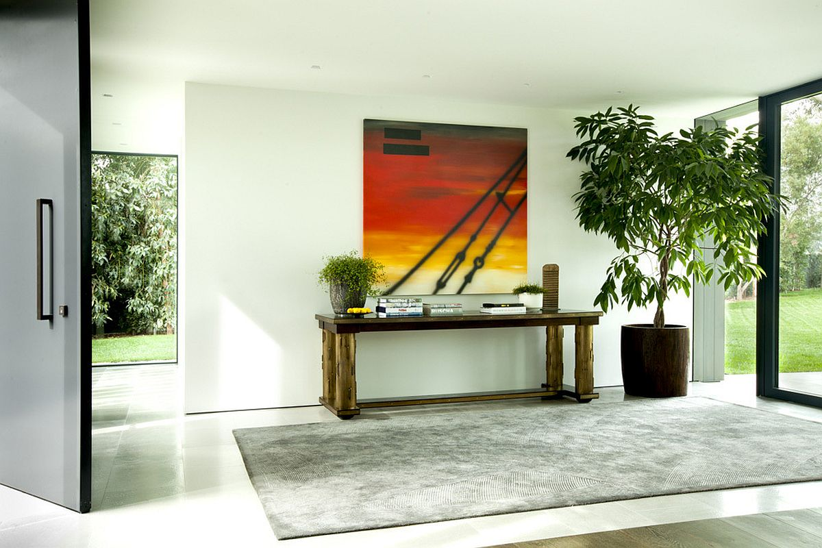 Entry design idea with a cool table and art work above