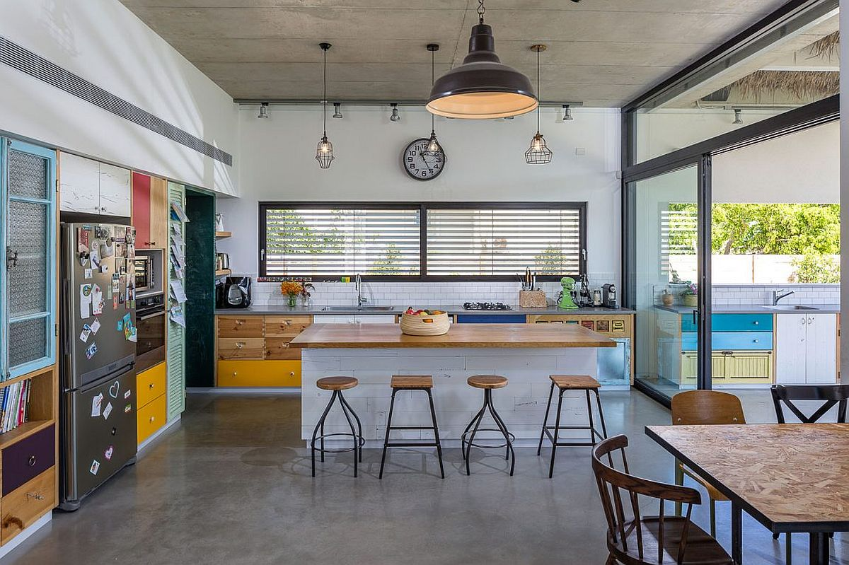 Exposed concrete floor and ceiling of the breezy family home in Hofit, Israel