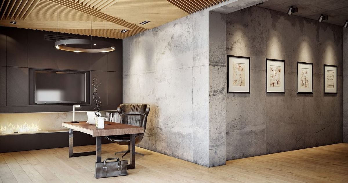 Exposed concrete walls create a unique gallery wall and home office