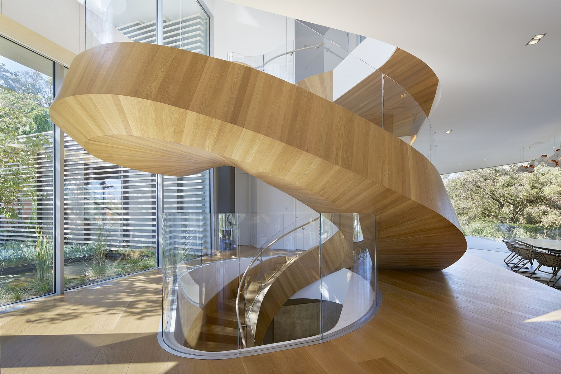 Exqlusive helical staircase design steals the show inside the sophisticated LA home