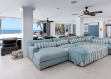 Exquisite-beach-style-home-theater-with-a-view-of-the-ocean-outside-217x155