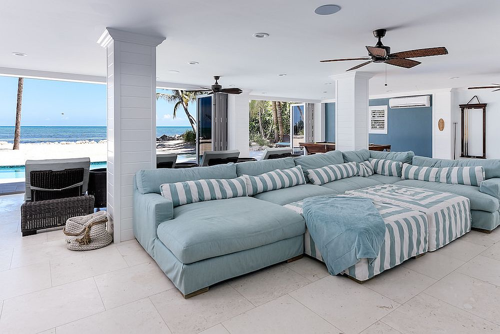 Exquisite beach style home theater with a view of the ocean outside [From: RTG Construction / Andy Frame Photography]