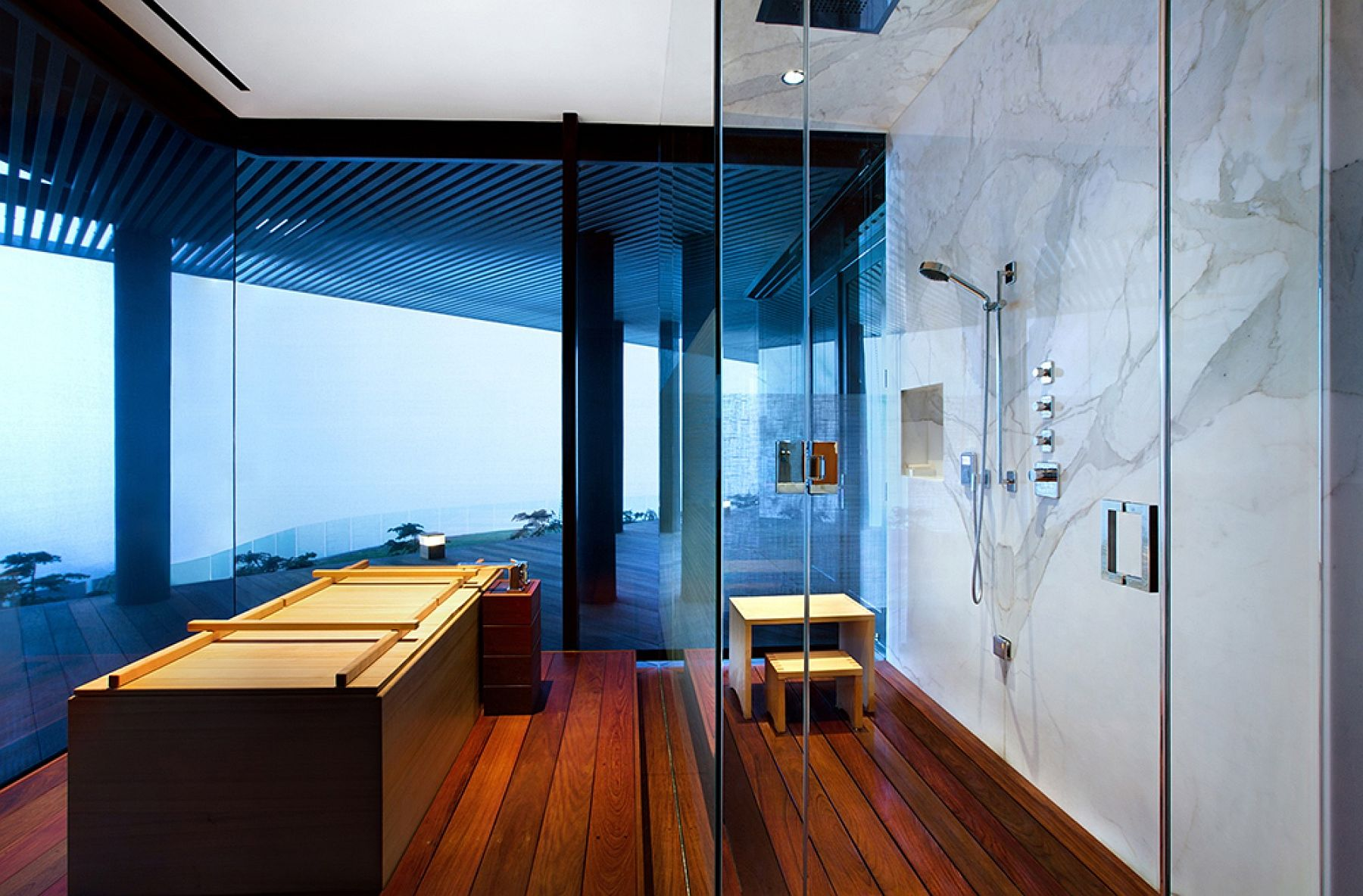 Exquisite contemporary bathroom with marble and glass shower area