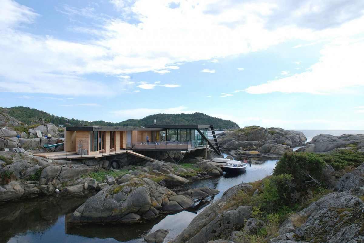 Exquisite holiday home built on an uneven rocky island above the water Taming Rugged Landscape: Enchanting Norwegian Holiday Home on a Small Island