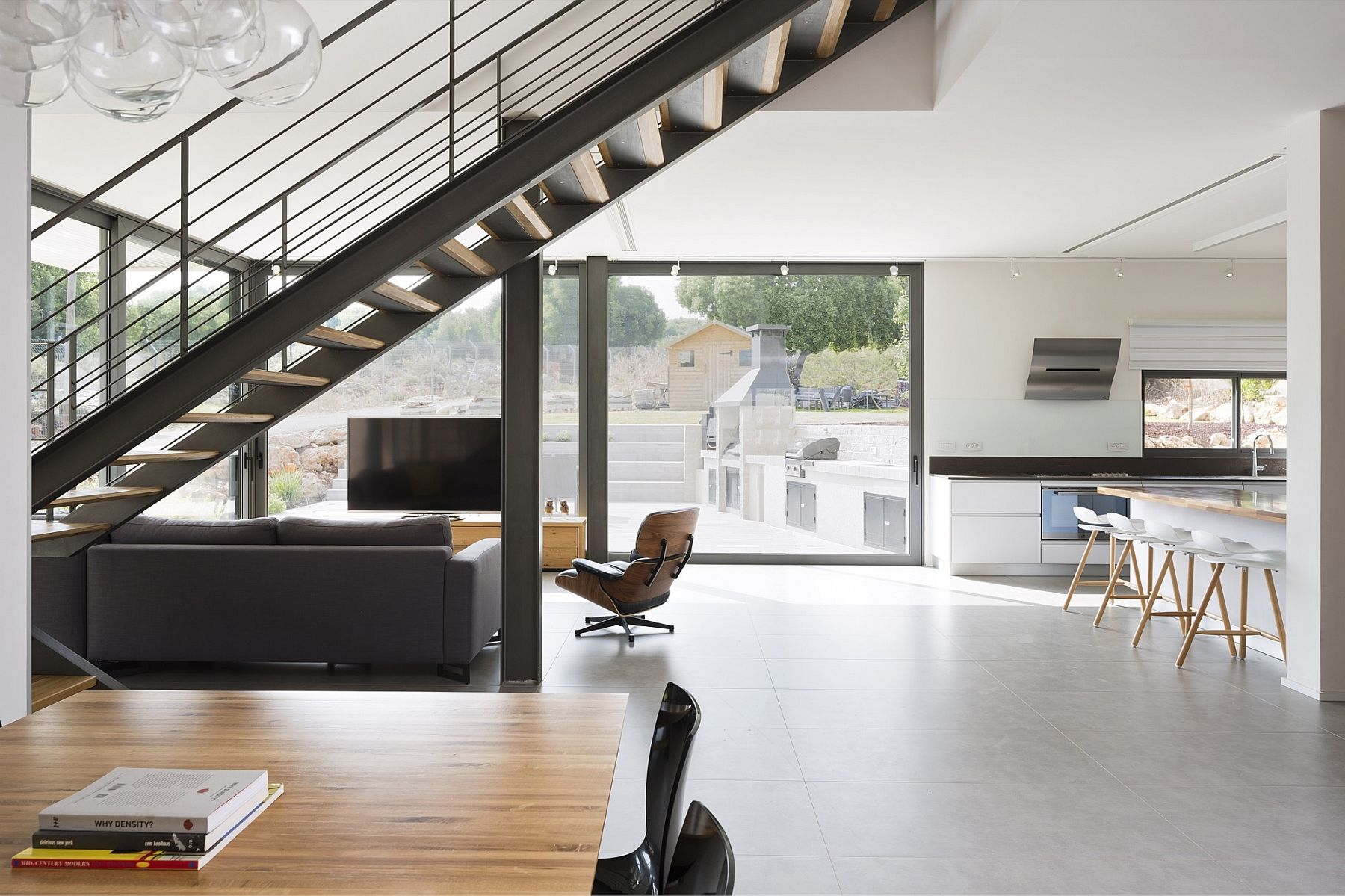 Exquisite metallic staircase connects the living area level with the master bedroom above
