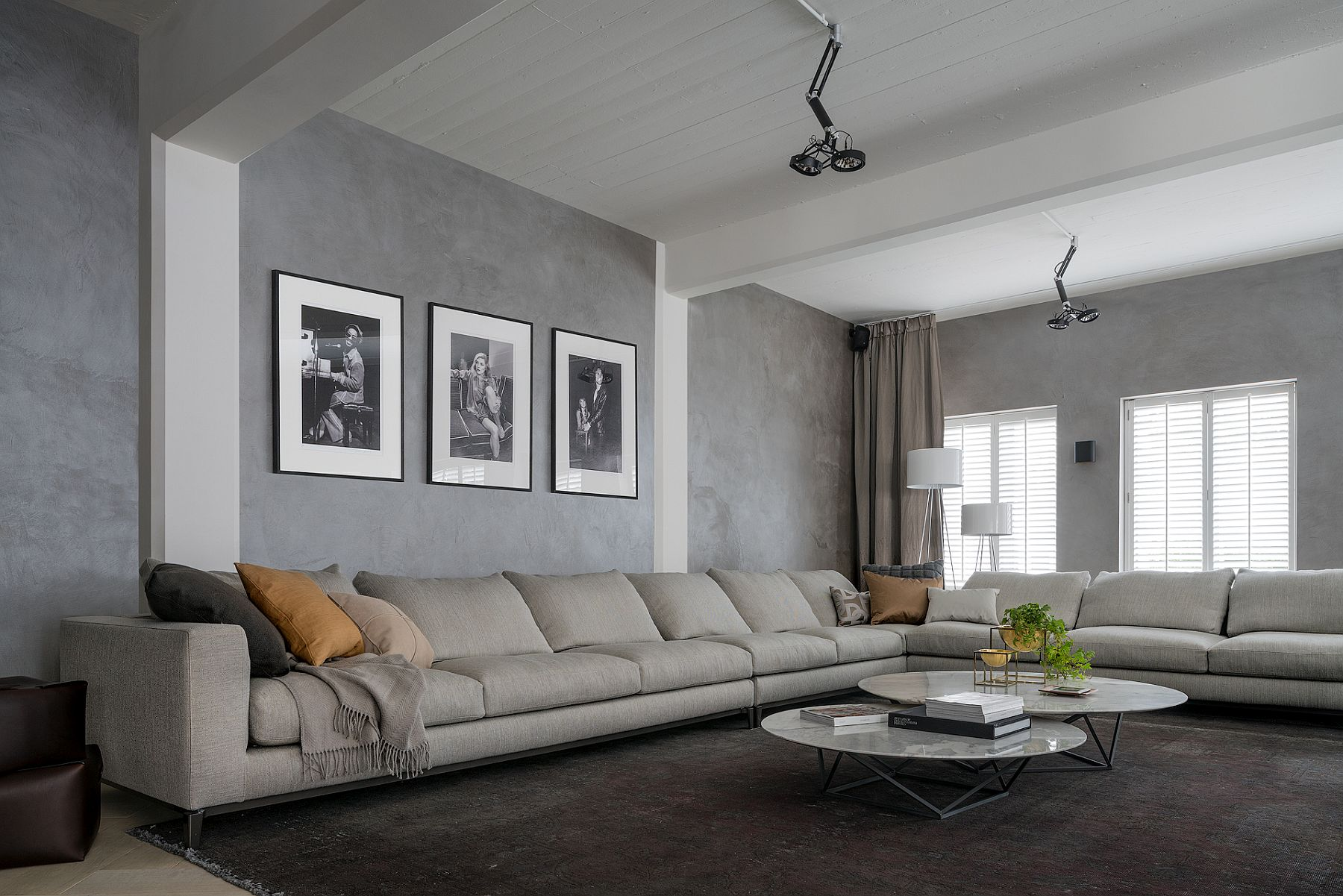 Fabulous Minotti corner sofa in gray for the industrial loft in Brussels