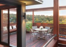 Fabulous modern mahogany rooftop deck with forest views