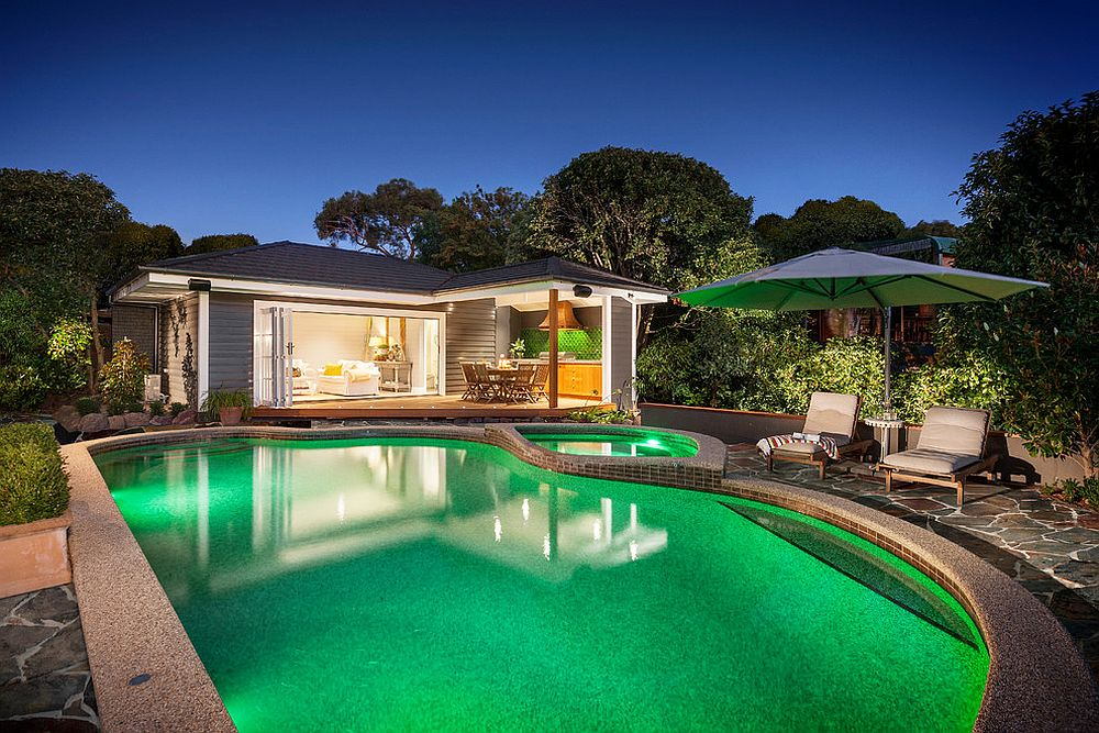 Pool Houses To Complete Your Dream Backyard Retreat - House with garden and swimming pool