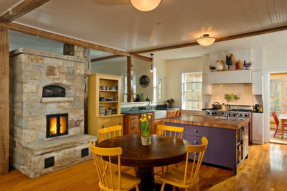 Farmhouse style kitchen of New York home with colorful decor and a lovely stone fireplace