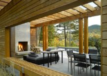 Fireplace and smart seating inside the contemporary pool house
