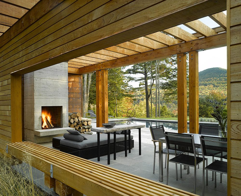 Fireplace and smart seating inside the contemporary pool house - 46+ Modern Small House Design With Pool  PNG
