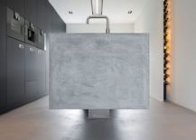 Floating-concrete-kitchen-island-and-innovative-wine-storage-space-217x155
