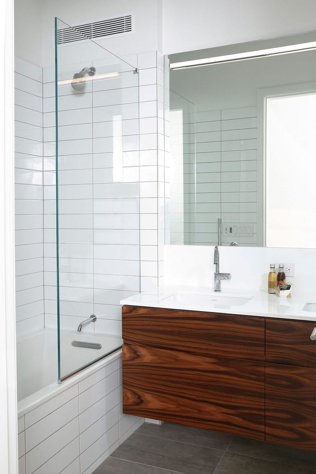 Floating wooden vanity with polished countertop in the bathroom