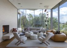 Floor-to-ceiling-glass-walls-offer-unabated-views-of-the-green-valley-below-217x155
