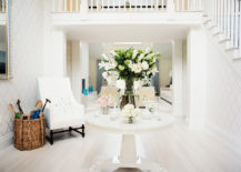 Foyer-table-with-floral-arrangements-via-Lonny-217x155