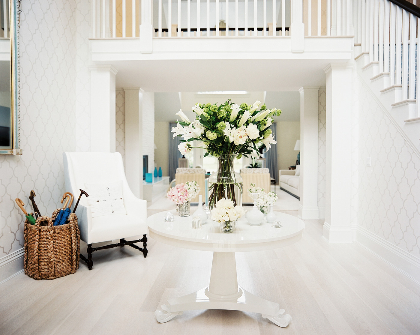 Foyer table with floral arrangements via Lonny