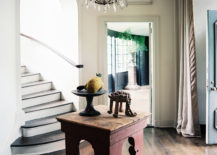Foyer with a chandelier via Lonny