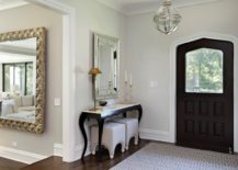Foyer with a console table via 2 Design Group