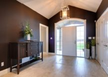 Foyer-with-a-console-table-via-Quality-Construction-Services-217x155