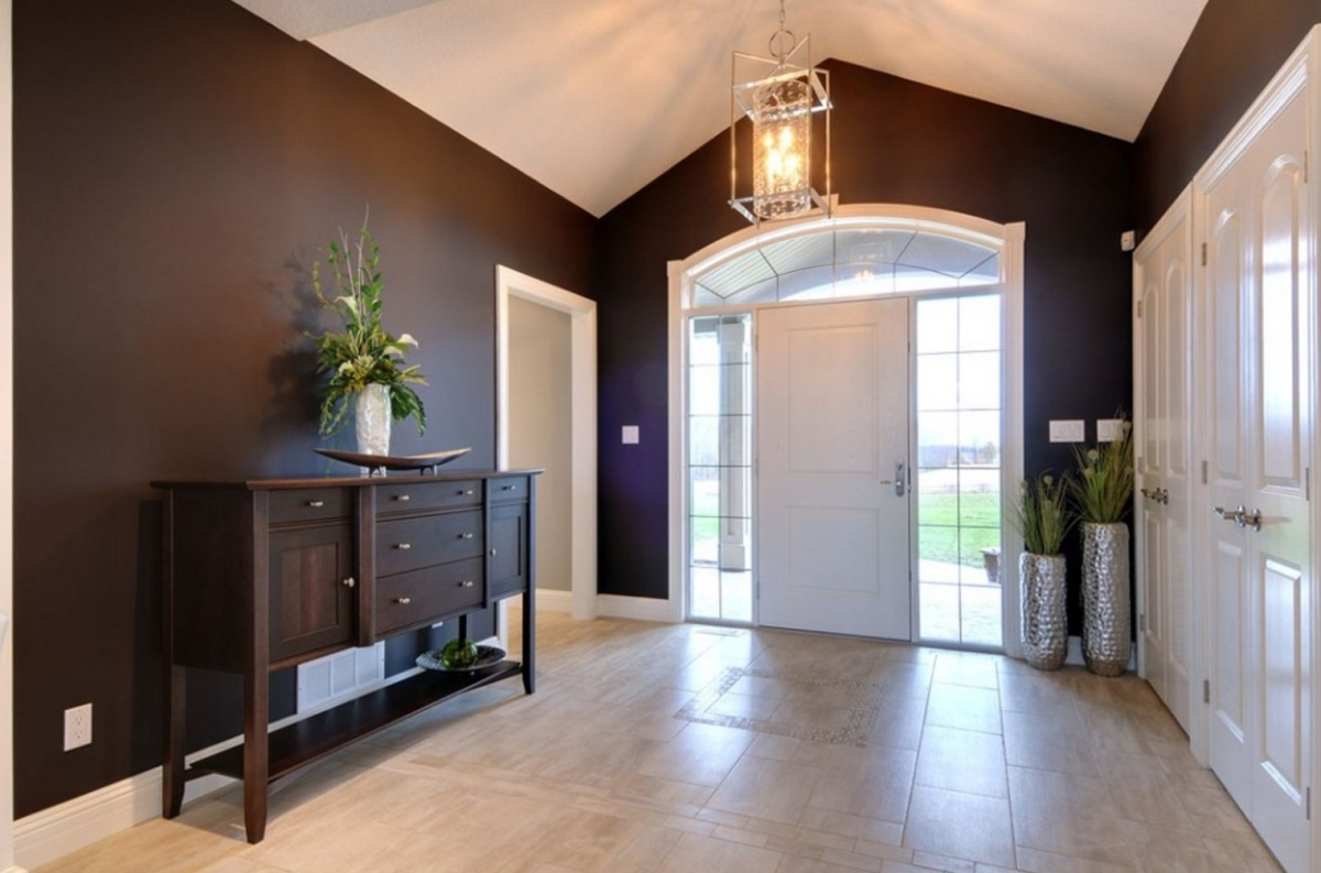 Foyer with a console table via Quality Construction Services