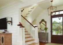 Foyer with a pendant light via Structures Building Company
