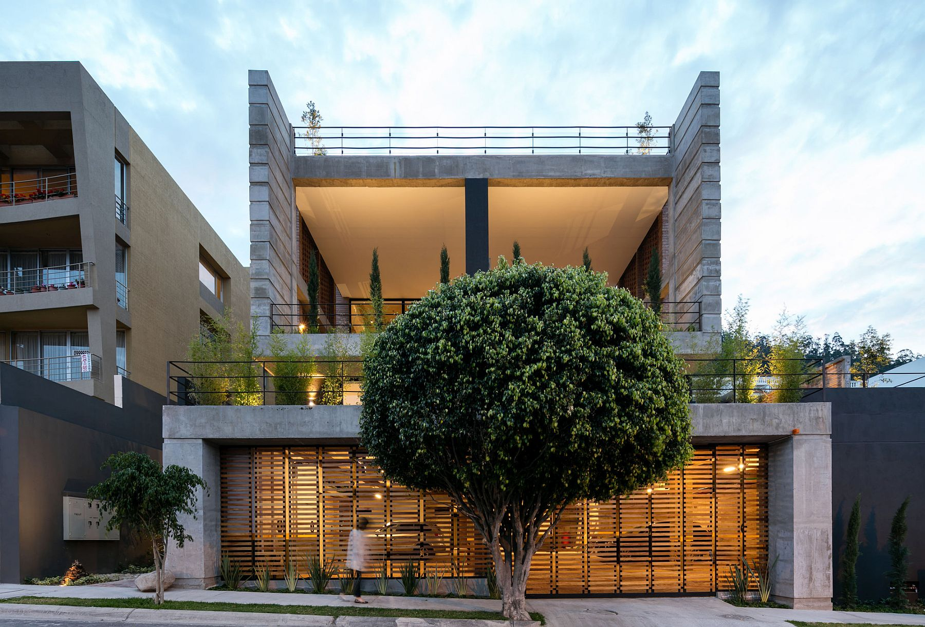 Front facade of teh building combines unabated views with ample privacy