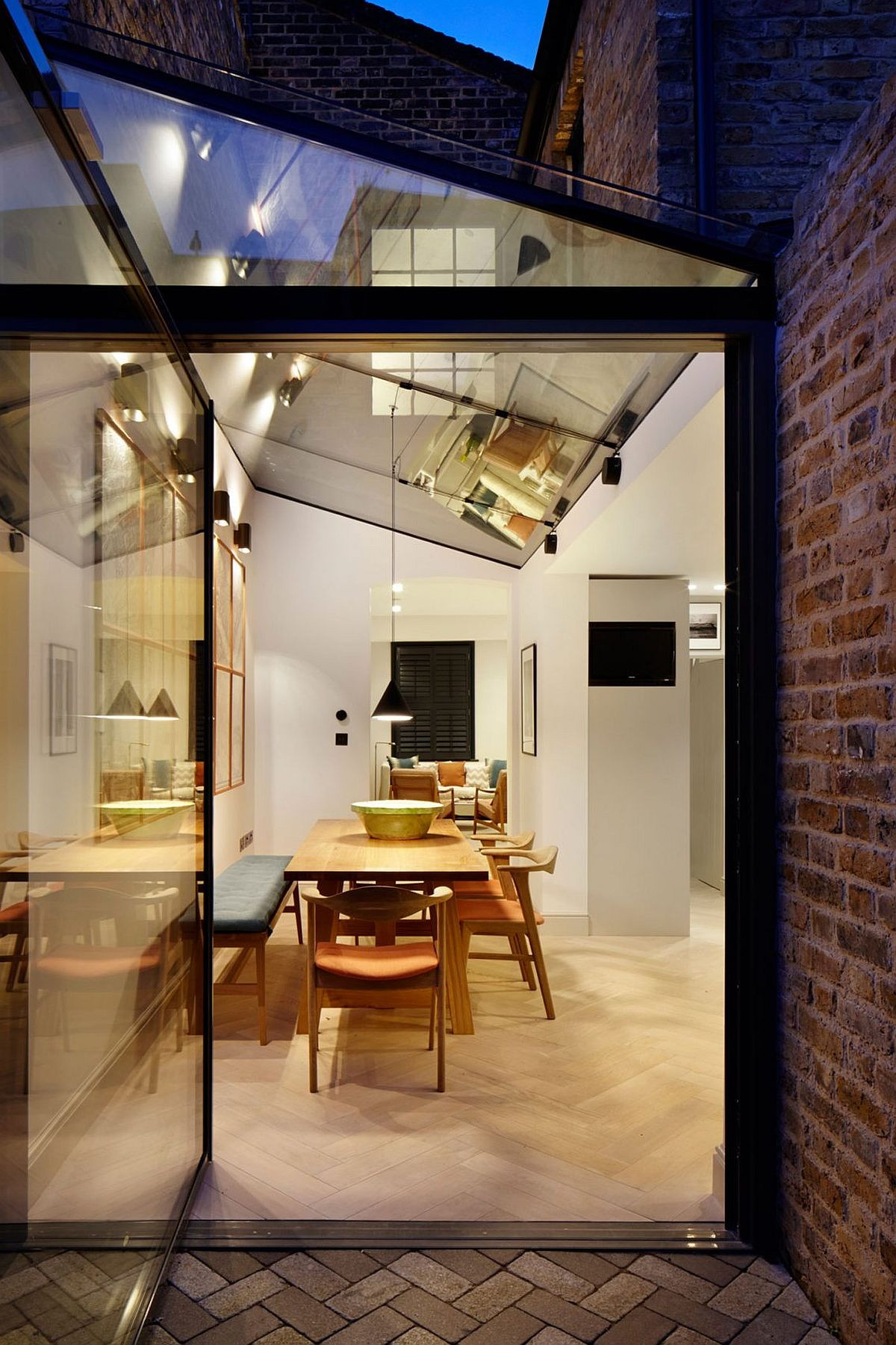 Glass and steel extension of the classic London home in brick