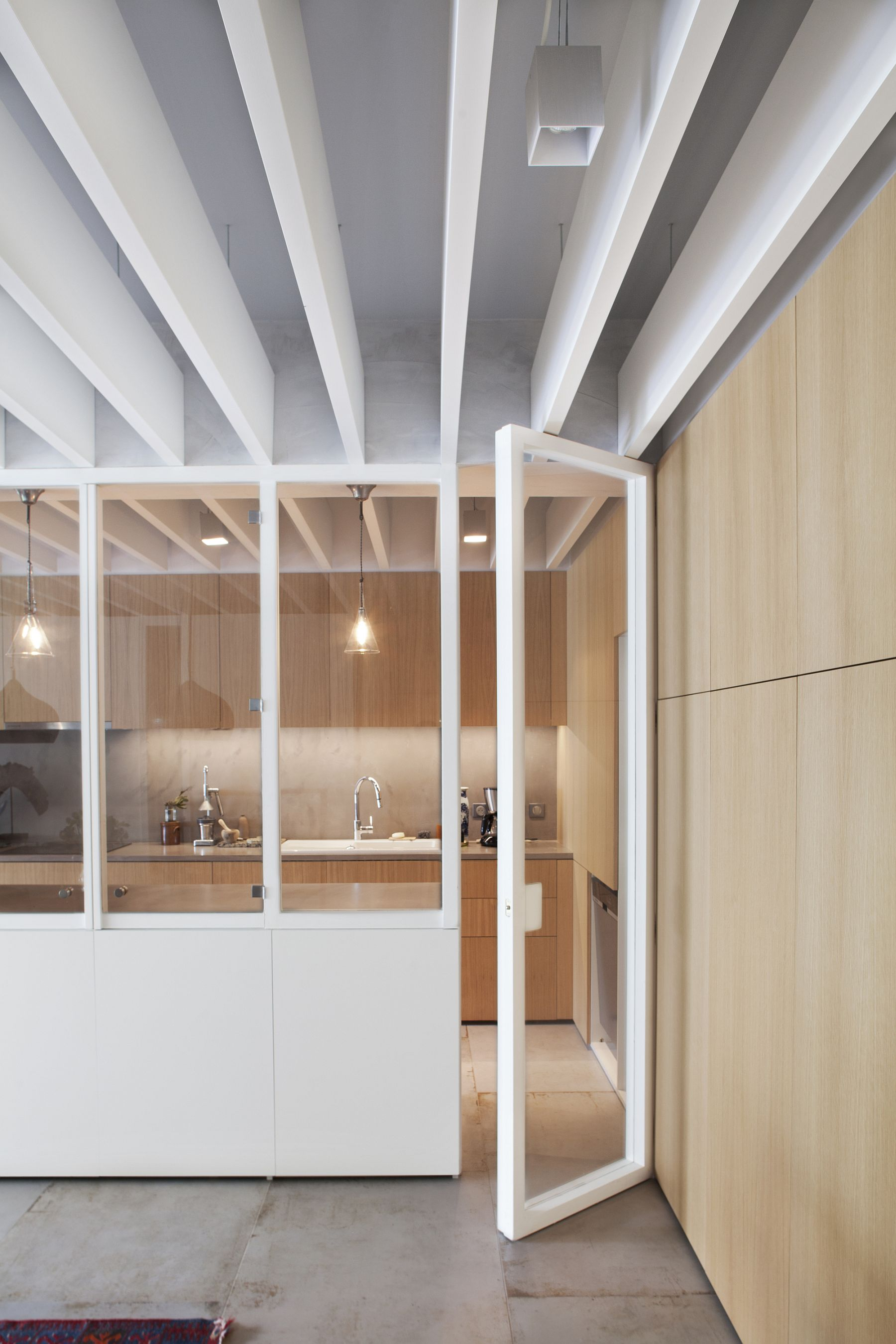 Glass doors and walls allow for unobstructed flow of natural light