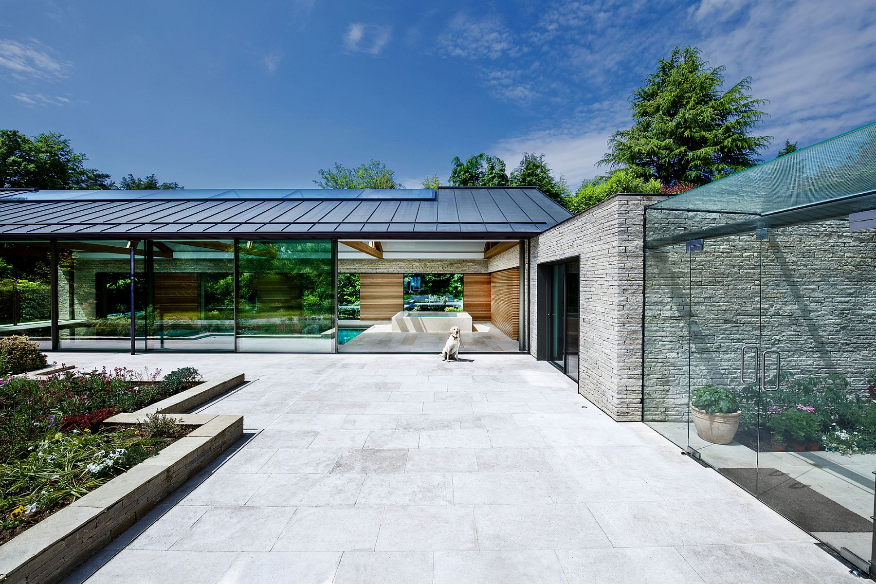 Glazed-sliding-glass-doors-reflect-the-landscape