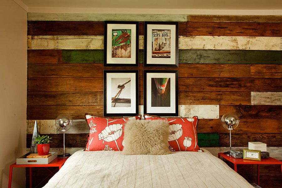 Gorgeous beach style bedroom with a unique reclaimed wood accent wall [Design: Garrison Hullinger Interior Design]