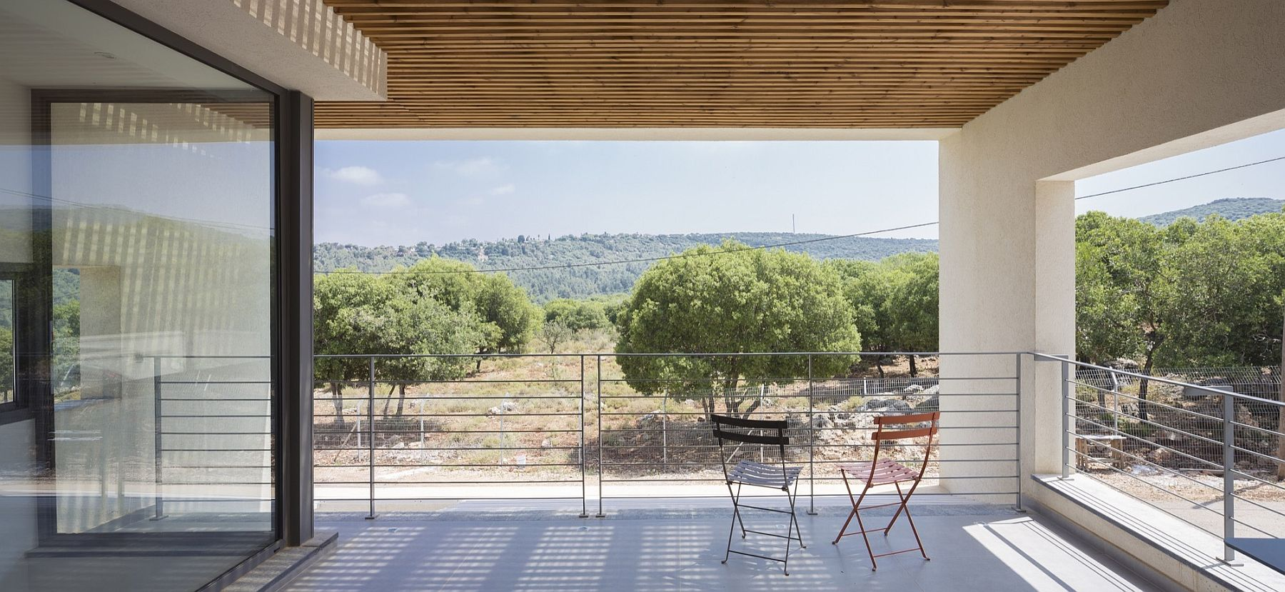 Gorgeous covered deck that overlooks the landscape and beyond