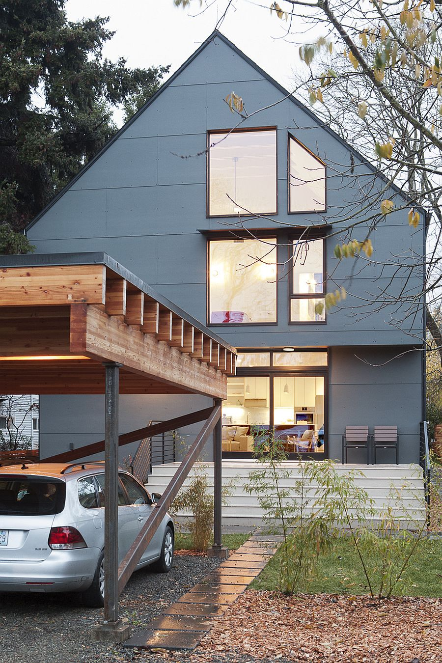 Gray exterior of the modern home with green design