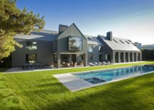 Gray-painted cedar and slate roof tiles shape the exterior of the revamped home