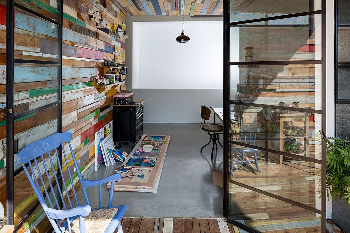 Home studio with color reclaimed wood wall