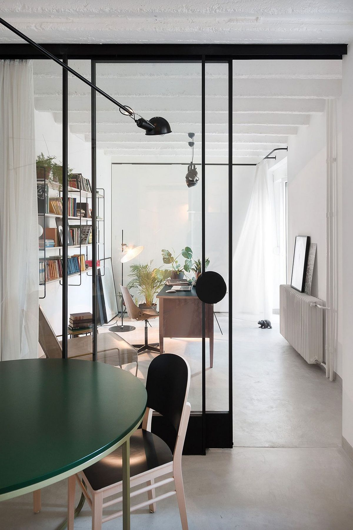 Home study and dining room of the contemporary apartment with smart decor