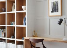 Home workspace and shelving space with sleek wooden desk