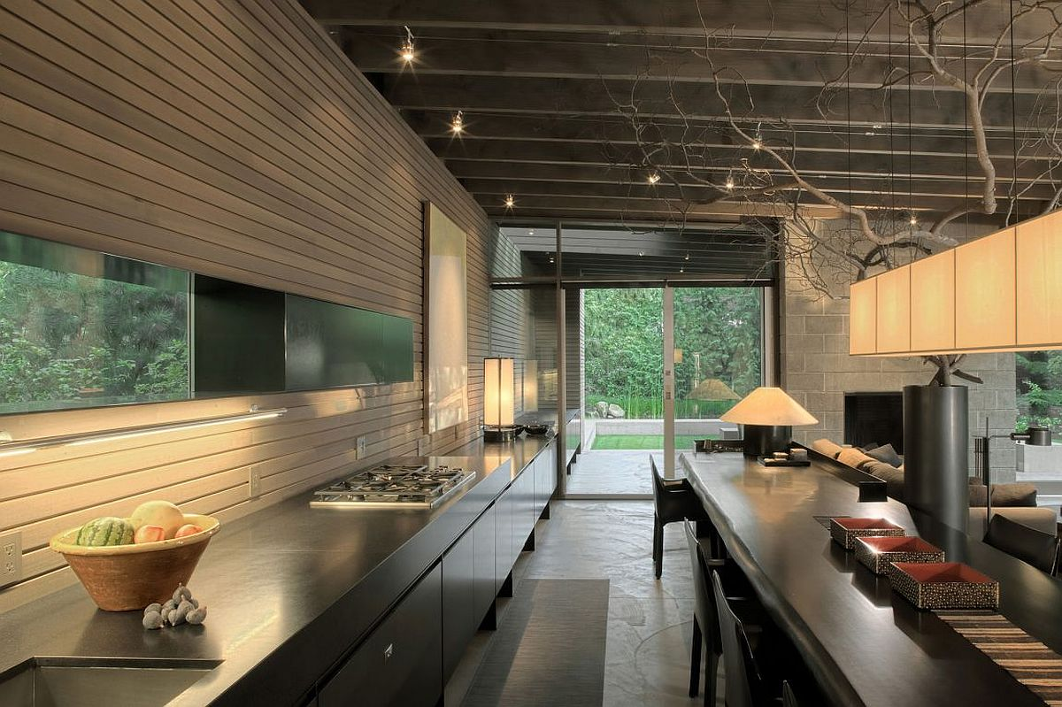 Indoor kitchen station extends outside to create an integration of both the spaces