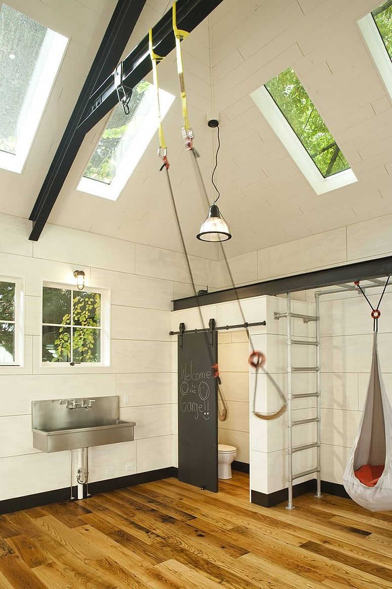 Industrial kids' playroom that was previously a garage [From: Menter Byrne Architects / Subtle Light Photography]