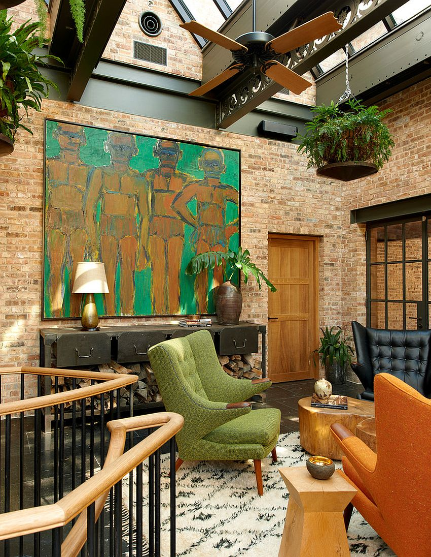 Industrial sunroom with midcentury decor, bright wall art and tropical ceiling fan [From: Lieberbach & Graham / Tony Soluri]