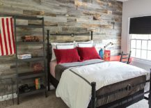 Iron-bed-and-reclaimed-wood-wall-bring-plenty-of-texture-to-the-boys-bedroom-217x155