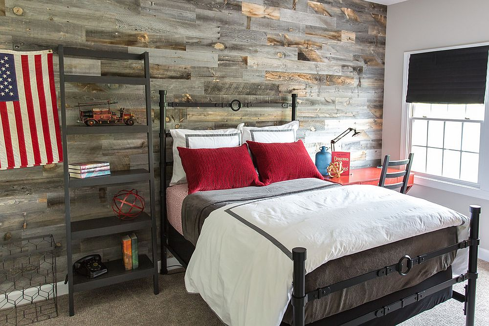 Iron bed and reclaimed wood wall bring plenty of texture to the boys' bedroom [From: Haus Interior Design / Helen John Photography]
