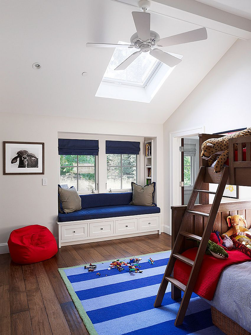 Kids' bedroom with bunk bed, a lovely window seat and skylight [Design: Taylor Lombardo Architects]