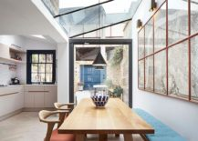 Kitchen and dining room of the revamped London home connected with the outdoor lounge