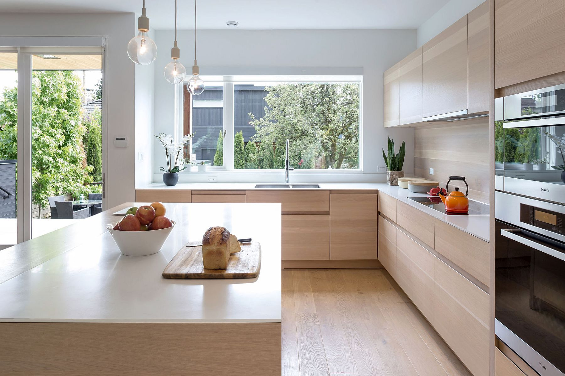 Kitchen that overlooks deck and garden outside