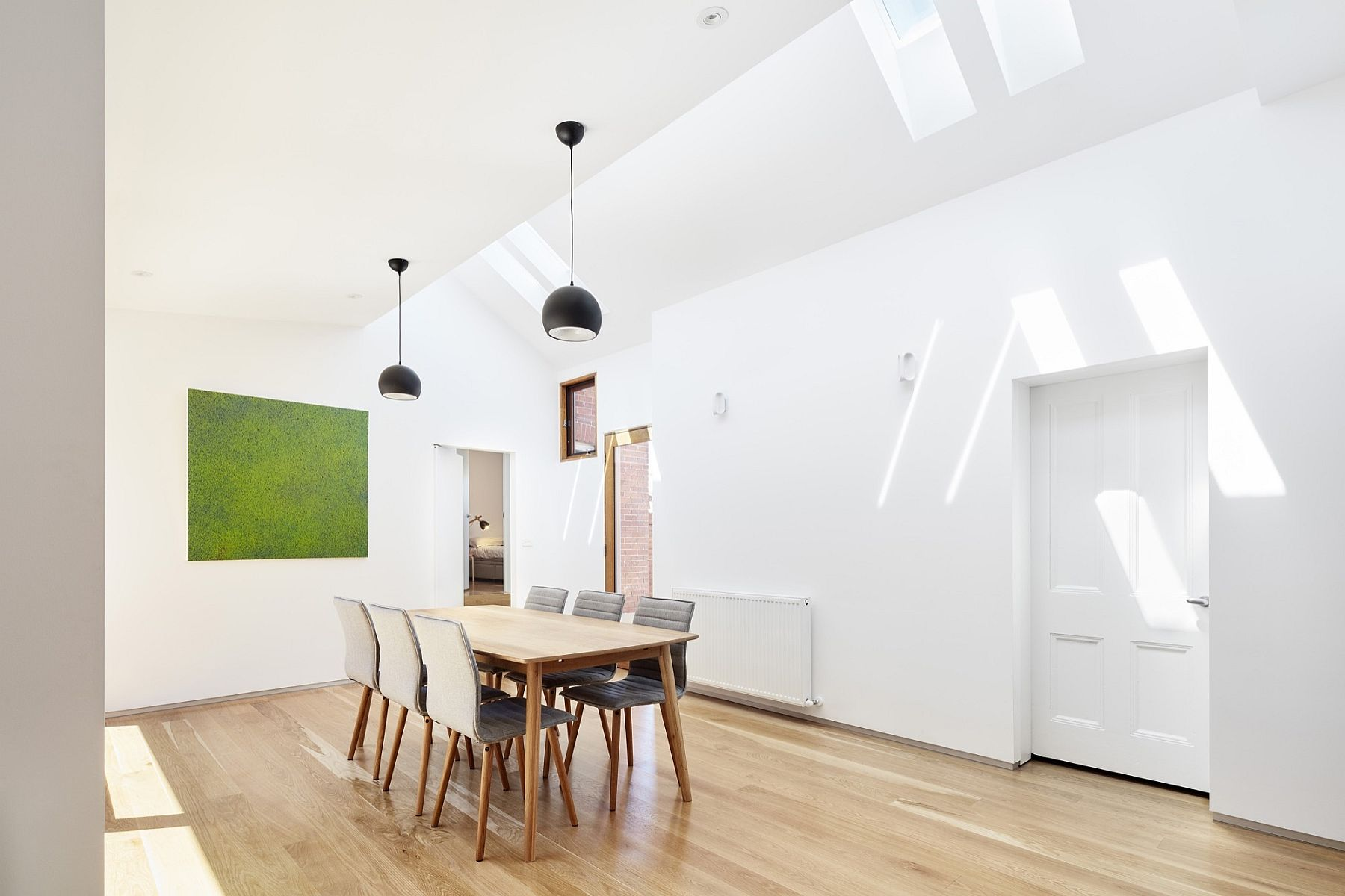 Large, sweeping dining room with skylights