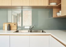 Light-filled revamped kitchen with corner shelving