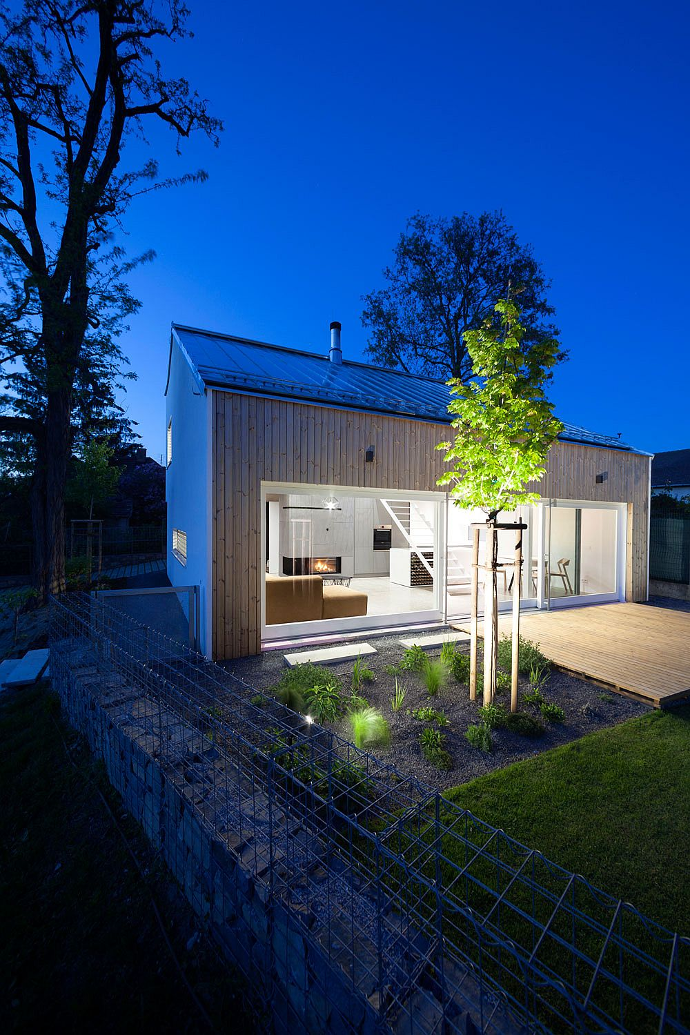 Lighting adds ambiance to the garden and the deck